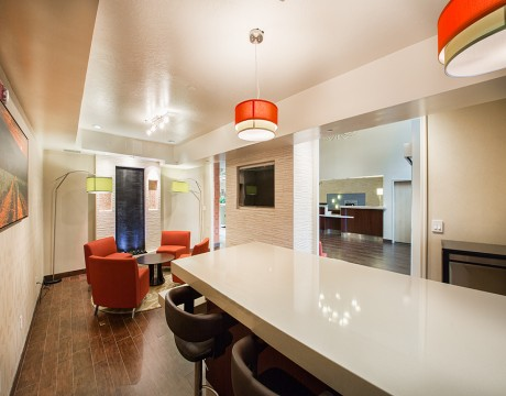 Holiday Inn Express and Suites MH - Lounge Area with High Table